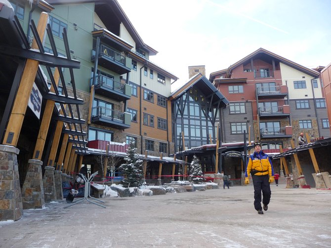 Steamboat Ski and Resort Corp. Ambassador Robb Stevenson walks through the new promenade in front of One Steamboat Place on Wednesday. The luxury condominium project had 13 sales close Monday for a total of $15.25 million.