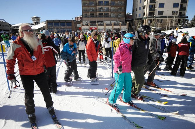 Skiers line up to board Christie Peak Express on Thursday at Steamboat Ski Area. This year's first effective lodging forecast shows tourism trends similar to last year's, predicting a 20 percent occupancy rate Saturday.