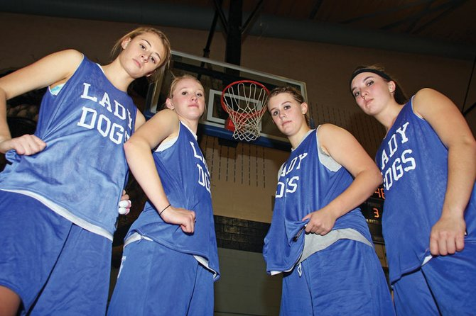Moffat County High School post players, from left, juniors Lauren Roberts and Britteny Ivers, and seniors Lindsey Yoast and Jessi Moser will have to hold their ground for the MCHS girls varsity basketball team this season. The post players voted Roberts as the team's best rebounder.