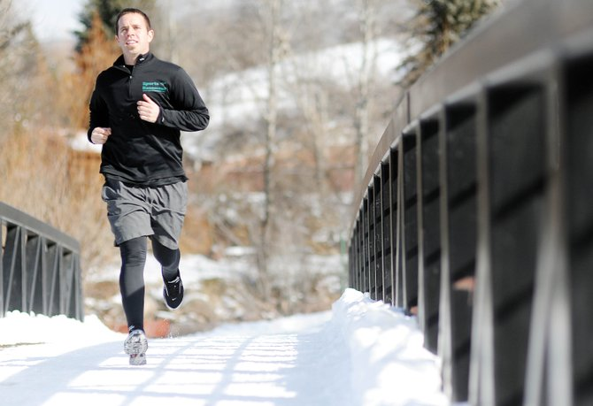 Stephen Remillard runs Wednesday on the Yampa River Core Trail in Steam­boat Springs. Remillard has run in several marathons and is helping raise awareness for essential tremors, a disorder he has dealt with since childhood.