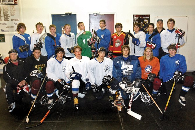 The Moffat County Bulldogs club hockey team is filled with returning players and new faces. The team is, back row, from left, Taylor Bangs, Michael Samuelson, Jarrod Stillion, Bubba Ivers, Jarret Walt, Jarred Blevins, Dru Nielson, Steven Wagner, Ethan O'Mailia, coach Jerry Strahan and CJ Walt. Front row, from left, is coach Walker Criswell, Ben Magnuson, Sean Southard, Wyatt Villa, Ty DeGuelle, Spencer Wayman, Kelsie Pomeroy and Jake Blevins.