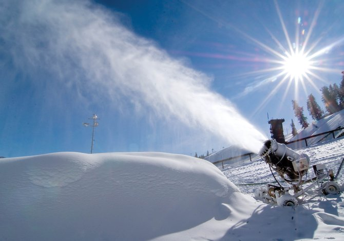 A snow gun coats the slopes of Howelsen Hill in downtown Steamboat Springs. The blue sky dominated Monday's weather, but forecasts are calling for a 20 percent chance of snow Wednesday night into Thursday.