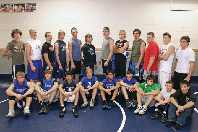 Introducing the 2009 Moffat County High School wrestling team. Pictured, back row, from left, are Kye Adams, Scott Mann, Todd Stewart, Asay Crofts, Nick Chew, Nathan Tomlin, Matt Linsacum, Charlie Griffiths, Cody Adams, Ben Winslow, Cody Nelson and Justin Zufelt. In the front row, from left, are Wyatt Uptain, Trent Enochs, Jesse Maneotis, Garret Stewart, Jake Teeter, Jake Blevins, Jake Bingham, Justin McAlexander and Hunter Richardson