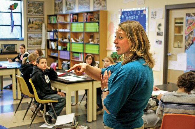 Brynna Vogt lectures her seventh-grade science class Thursday at Craig Middle School. Vogt uses humor to relate to her students and engage them in the lessons.