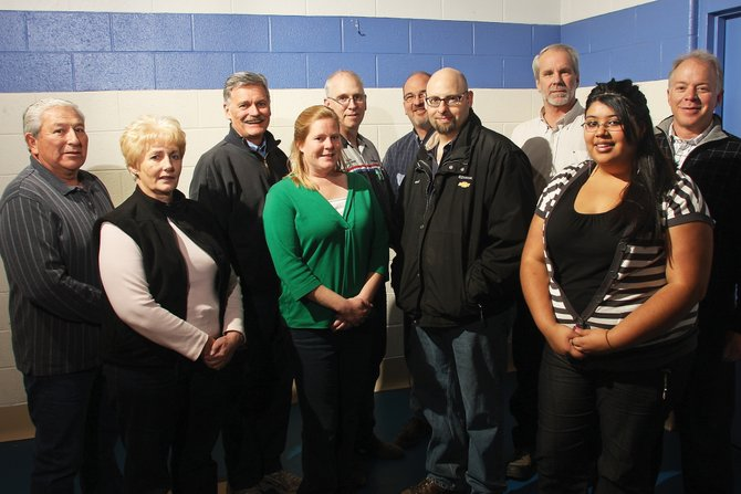 The Boys & Girls Club of Craig will honor its chosen people of the year at tonight's Cowboy Christmas fundraiser. Front row from left, are Goldie Arroyo, Nikki Webber, Paul Pinkham and Carina Meza. Back row from left, are Joe Arroyo, state Sen. Al White, Dave Lyons, Joe Bird, John Knoche and Scott Cook.