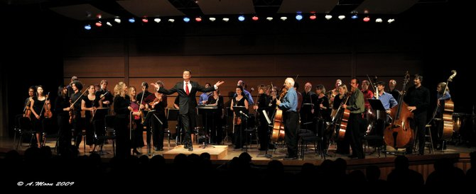 The Steamboat Springs Orchestra plays its annual holiday concert at 8 p.m. Saturday and at 3 p.m. Sunday at Steamboat Christian Center. Here, music director Ernest Richardson leads the orchestra after a bow after its season-opening concert in the  fall at Strings Music Pavilion.