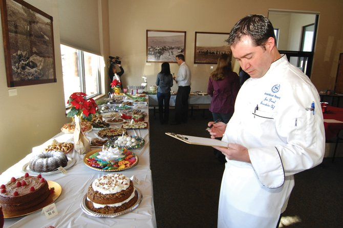Jon Demel, executive chef at the Sheraton Steamboat Resort, checks out the holiday treats Thursday during the first Holiday Dessert Bake-off at the Steamboat Pilot & Today offices.