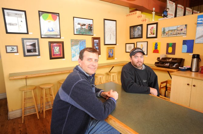 Azteca Taqueria owners Jim Ruggiero, left, and Jonas Gabriel have added their restaurant to the First Friday Artwalk lineup.