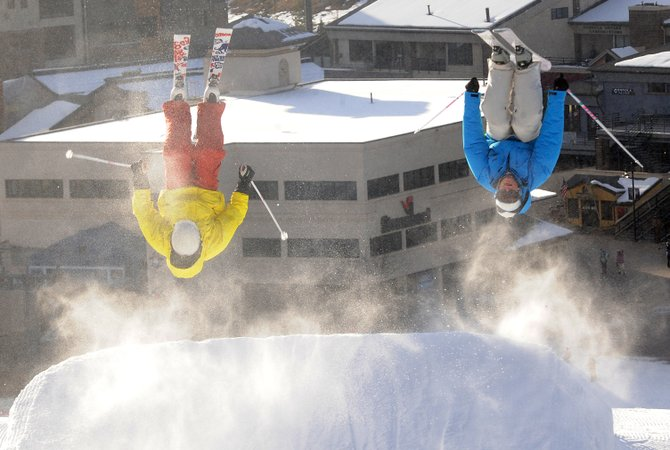 Adam Smith, left, and Elijah Mueller do simultaneous flips off a kicker in the Lil' Rodeo terrain park near the base of Steamboat Ski Area. The park was a feature added to the resort for the first time last year and has become a very welcome place for snowboarders and skiers to spend their time while they wait for more snow and eventually larger terrain parks.