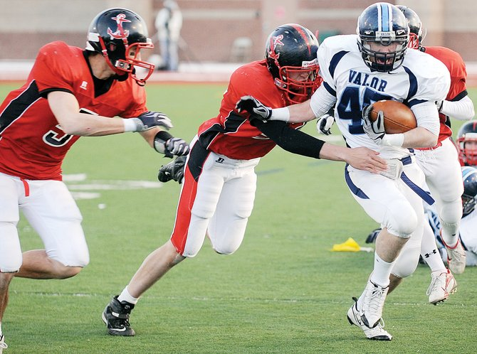 Valor Christians Matt Corral sheds a pair of Steamboat defenders Saturday during the Class 3A state championship football game in Aurora. The Eagles had too many big plays for Steamboat to stay close and went on to win the game, 41-14.