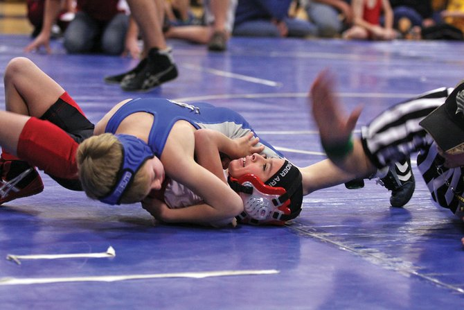 Luke Pleasant pins his opponent Saturday during the Craig Bad Dogs Winter Rumble at Moffat County High School. The tournament is the lone home contest of the winter season for the Bad Dogs.