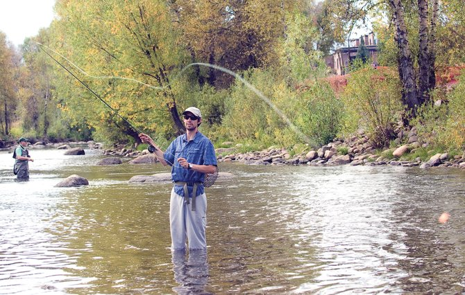 World Champion Nordic combined skier Johnny Spillane is at home on the Yampa River in Steamboat Springs. Spillane not only enjoys fly-fishing, but he also guides when he has time.