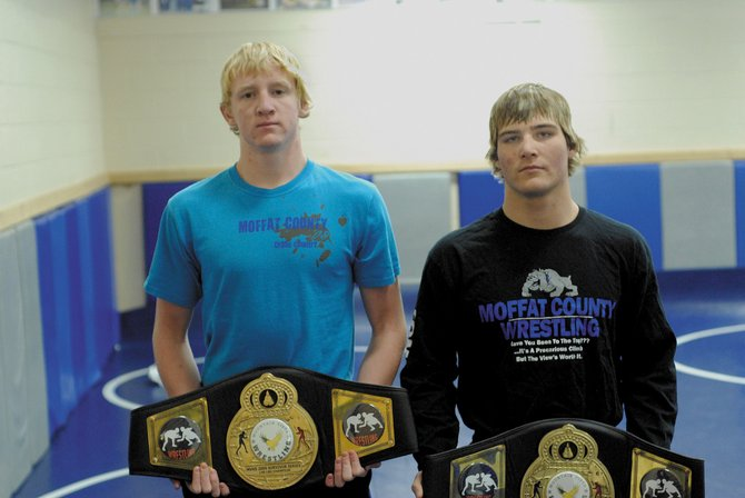 Charlie Griffiths, left, and Nathan Tomlin won belts for finishing 10-0 in the 140- and 152-pound classes, respectively, at the Mountain Vista Survivor Series. Overall, the Moffat County High School boys varsity wrestling team finished 66-46.