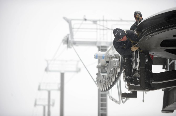 Leitner Poma of America employee Richard Dalrymple works in the snow Tuesday on the new Wildhorse gondola that will shuttle passengers from Trailhead Lodge to One Steamboat Place at the base of Steamboat Ski Area.