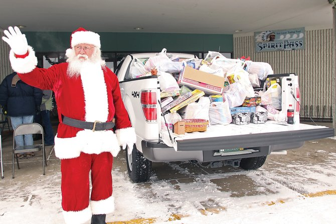 Santa Claus urges people Wednesday to donate to the KRAI Holiday Drive at Centennial Mall. The proceeds benefit Christmas for Kids, Christmas for Seniors, Interfaith Food Bank and Advocates-Crisis Support Services.