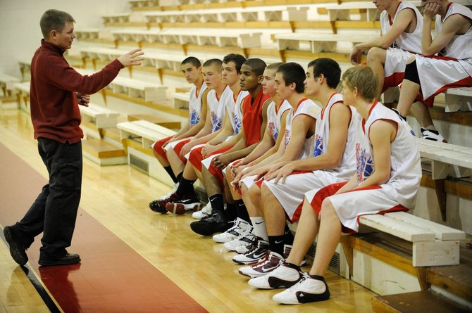 Steamboat Springs High School head basketball coach Luke DeWolfe talks to his players during practice Wednesday. The boys team starts the Steamboat Springs Shoot-Out at 6:30 p.m. today against Summit in the Kelly Meek Gymnasium. 