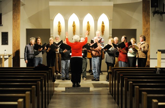 Marie Carmichael leads a rehearsal Wednesday of the Mountain Madrigal Singers at St. Paul's Episcopal Church. The group will perform at 7 p.m. today.