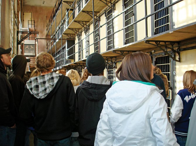 Students gaze up at the empty cells in the Wyoming Frontier Prison, a now-closed state penitentiary. The students are members of Joy Tegtman's criminology class at Moffat County High School.