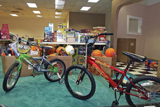 Bikes, basketballs, fishing poles, hula-hoops, skateboards, action figures and dolls are just a few of the thousands of items collected during the 2009 KRAI Holiday Drive. The toys will be separated into bundles and given to families in need.