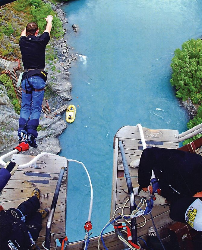 Wesley Chapman, 15, takes a leap from the deck of the Kawarau Bridge, outside of Queenstown, New Zealand. The bridge is known as the birthplace of bungee jumping. Chapman recently spent two weeks exploring the country with his grandparents, Melvin and Holly Norman.