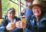 Wesley Chapman, 15, on left, cheers his grandfather, Melvin Norman, 70, during a trip to New Zealand.