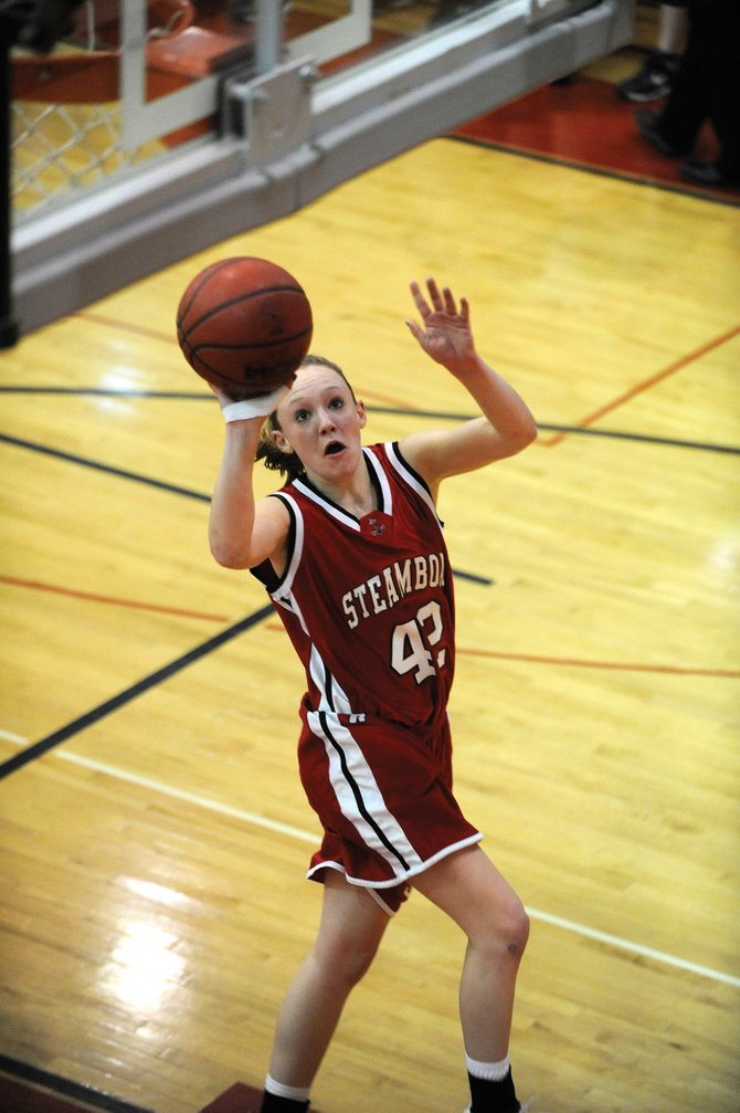 Steamboat Springs High School senior Matthia Duryea puts up a shot during the first quarter of Friday night's game against D'Evelyn High School. The girls lost, 66-47.