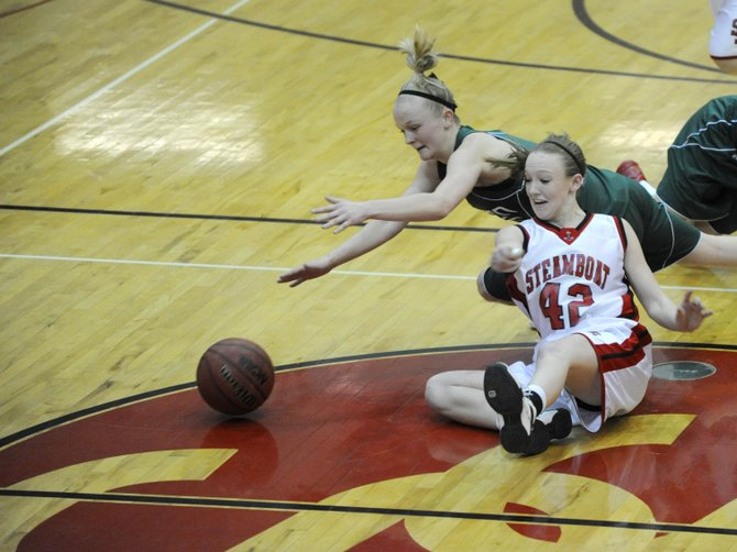 Steamboat Springs High School senior Matthia Duryea fights for a loose ball during Saturday&#39;s game against Green River. Both the Steamboat and Hayden boys and girls teams leave today for a tournament in Green River, Wyo.