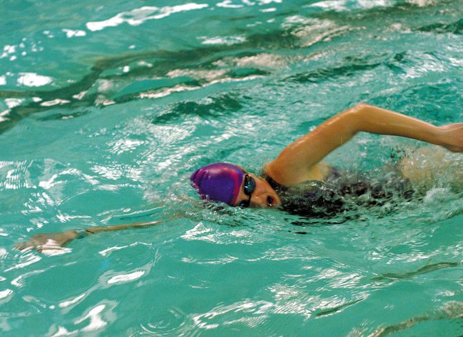 Eryn Leonard completes a practice lap Thursday at the Moffat County High School pool. Leonard and her teammates will participate in the Moffat County Invitational starting at 10 a.m. Saturday at MCHS, 900 Finley Lane.
