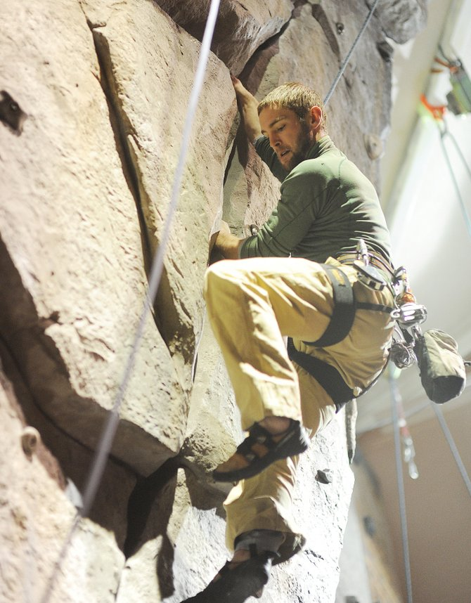 Patrick Meyer works his way up the climbing wall in Steamboat Springs Middle School on Wednesday night at one of the twice-weekly climbing nights.