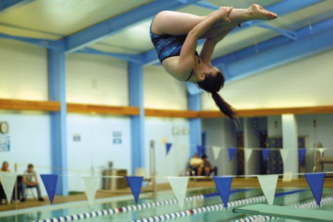 Larissa Grammer, Moffat County High School diver, performs a dive Saturday during the Moffat County Invitational at the high school. Grammer finished first in diving in the team's first home meet of the year.