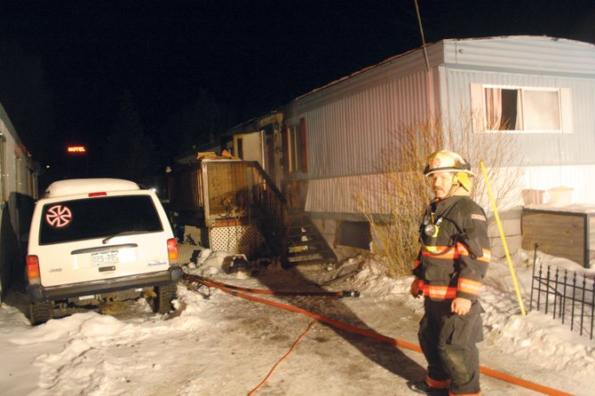 Oak Creek Fire Protection District Chief Chuck Wisecup looks at the destroyed mobile home on Willow Bend Court after firefighters extinguished a blaze reportedly set by a man attempting to unfreeze pipes with a hand-held blow torch. Wisecup said the unit is likely a complete loss.