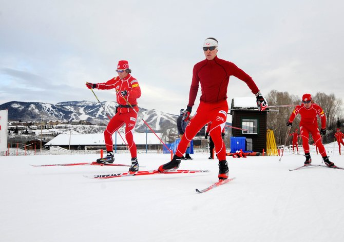 U.S. Ski Team members Taylor Fletcher, left, and his brother Bryan, right, test out the cross-country course at the rodeo grounds at Howelsen Hill on Tuesday with Bill Demong. The National Weather Service's Grand Junction office is forecasting a couple of inches of snow during today's 2010 U.S. Winter Olympic Team Trials in Steamboat Springs.