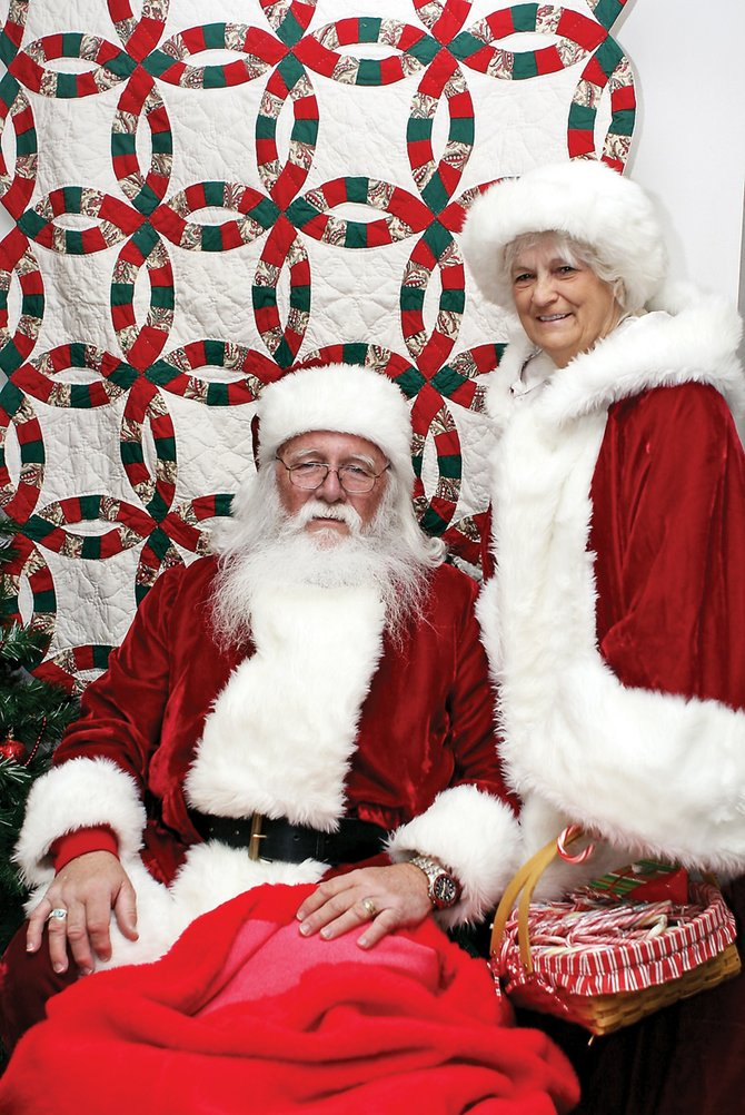 Mr. and Mrs. Santa Claus gave away gifts and candy canes Tuesday during a Christmas party at the Craig Fire Station. The Clauses and their reindeer have a very busy day today — Christmas Eve — with Christmas Day right around the corner. Despite their busy schedule, Mr. and Mrs. Claus were able to find time to sit down and talk with the Daily Press.
