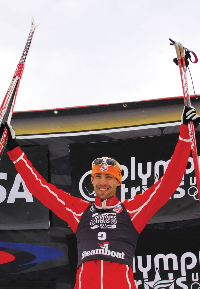 Steamboat Springs' Johnny Spillane steps onto the podium at Howelsen Hill after winning the 2010 U.S. Olympic Team Trials Nordic combined race Wednesday.