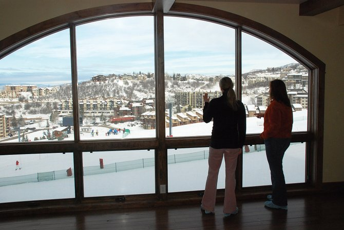Stephanie Fairchild and Angela Ashby, of Prudential Steamboat Realty, admire the views of the Stampede ski trail from a three-bedroom condominium at Edgemont that is on the market for $3.27 million. The developers closed their first six condos at the project this week for nearly a combined $13 million.