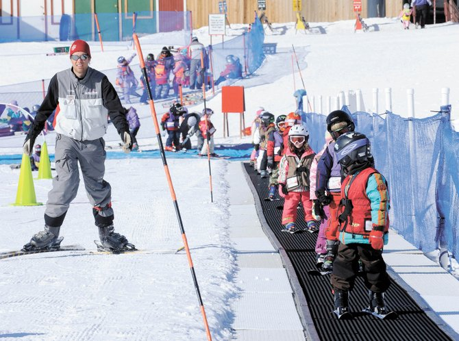 Steamboat Ski Area ski instructor Peter Thrane skis alongside his class last winter. The ski area has renewed its Kids Fly Free program, which began in 2001.