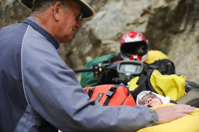 Kade Green is visited by his grandfather after Kade, 8, was rescued from alongside Fish Creek under the upper falls in June. Kade's mother, Rebecca, fell in trying to save him. Her body was recovered June 30.