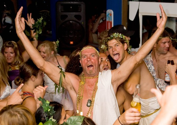 "Steve ""Zog"" Herzog raises his arms during a toga party at Sunpies Bistro. Herzog, a well known 49-year-old Steamboat Springs rugby player, died Wednesday from complications related to a sinus infection. A memorial service is being planned for sometime in January."