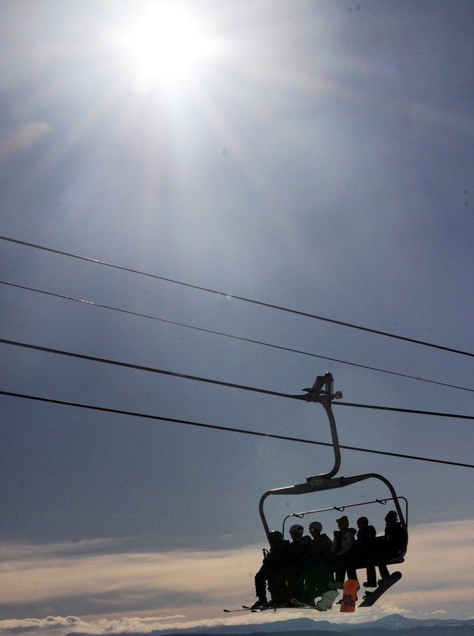 A full pack of skiers and snowboarders ride the Christie Peak Express chairlift at Steamboat Ski Area on Sunday. Holiday crowds flocked to the ski area all weekend. The Pony Express lift opens today as more snow is expected to hit by  Thursday. See the full story on page 5.