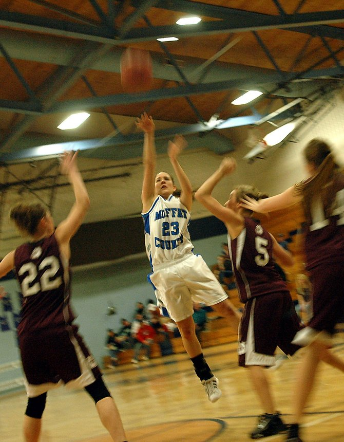 Ariel Sanchez, a Moffat County High School senior, knocks down a jumper in a January game against Palisade. The girls varsity basketball team finished the 2008-09 season with a 16-9 record, which they are looking to improve.