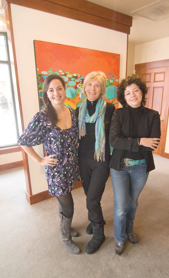 Leah Stettner, from left, Pat Walsh and Susan Schiesser stand inside the new RED Con­temporary art gallery. Walsh and Schiesser are partners in the new gallery located inside the Steamboat Sheraton Resort at the base of Steamboat Ski Area.