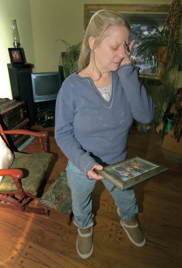 Eve Ege holds a photo of her husband, Dave, who died Nov. 13 from cancer. Eve and Dave Ege had planned to travel across the country writing books about handicap access at national parks before Dave Ege was diagnosed.