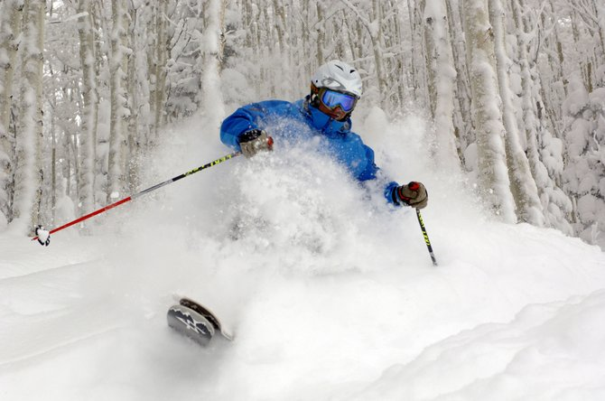 Steamboat resident Billy Gimes floats through the trees at the Steamboat Ski Area on Thursday.  2009 went out with a bang at the ski area, which reported more than a foot of snow overnight Wednesday.
