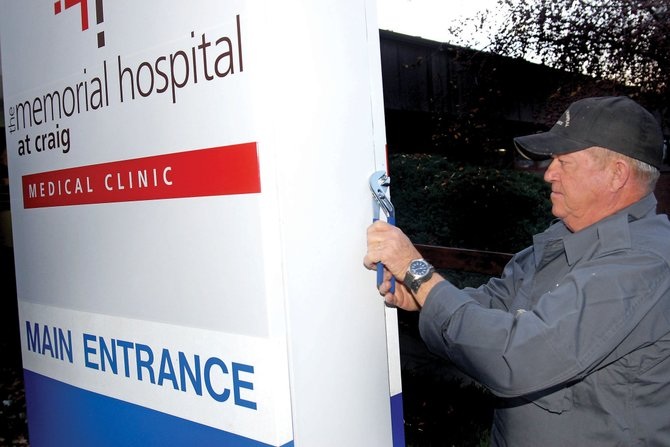 Orvie Zimmerman works to install a new sign at The Memorial Hospital Medical Clinic at 785 Russell St. in November 2009. The clinci, which resides at the former site of The Memorial Hospital, will undergo several renovations in the new year.