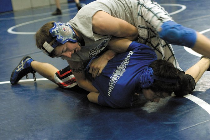 Cody Nelson, top, tries to pin Jacob Teeter during Monday's varsity wrestling practice. The Moffat County High School varsity wrestling team will travel Thursday to this weekend's Las Vegas Tournament.