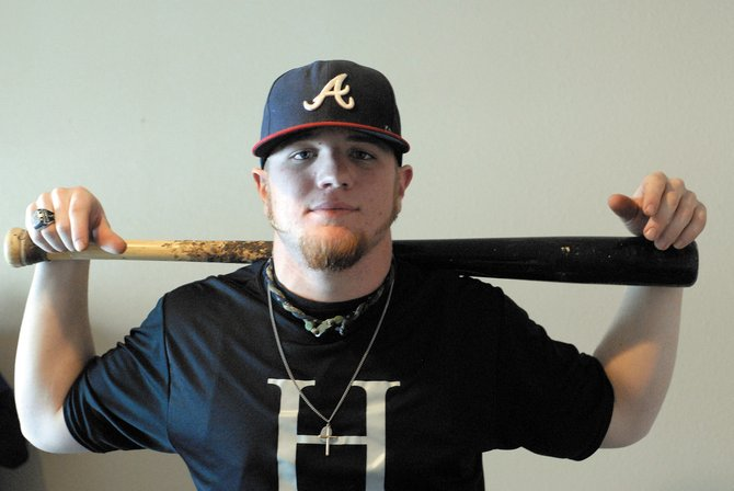 Brad Grinstead, 20, is a catcher for the Hendrix College Warriors. Last year, the 2007 Moffat County High School graduate helped the Warriors to a conference title.