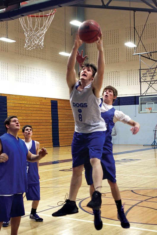 Brian Ivy, a Moffat County High School senior, grabs a rebound during practice Thursday. The varsity boys will host Eagle Valley High School at 7:30 p.m. today. The game is the home opener for the Bulldogs and also the team's first league game.