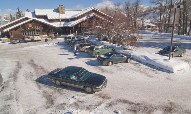Traffic moves through the parking lot at the downtown Steamboat Springs post office, where a new traffic pattern has been installed to accommodate an expected increase in use if postal services end Jan. 15 at the Sundance branch. Several residents are using petitions and appeals to try to keep retail services at Sundance, saying the downtown branch is not suited for more customers and traffic.