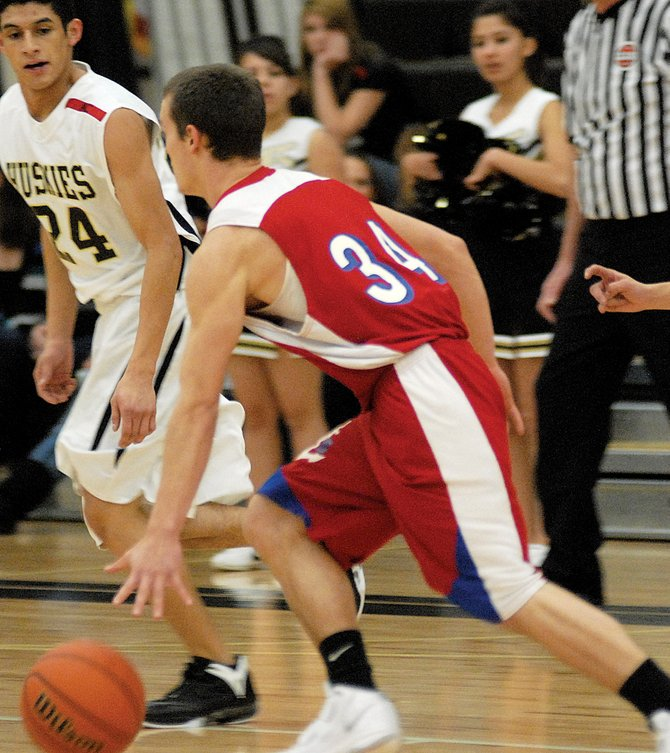Steamboat Springs' Charles Wood dribbles toward the basket Friday while playing Battle Mountain in Edwards. Steamboat Springs won, 55-43.
