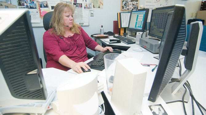 Lead dispatcher Serena Whited handles a 911 call inside the Routt County Communications Department last week.